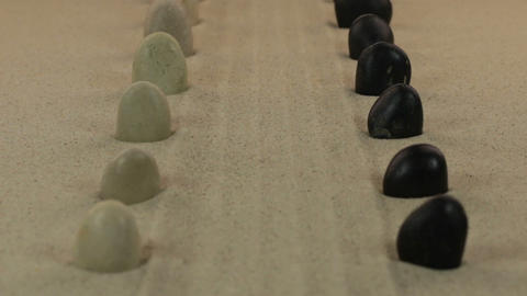 Approximation of two rows of white and black stones, lying on a lines from the Footage