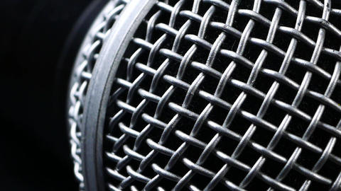 Steel grille background. Close-up shot of microphone Footage