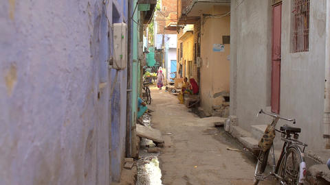 A shot of a narrow street in urban India Footage