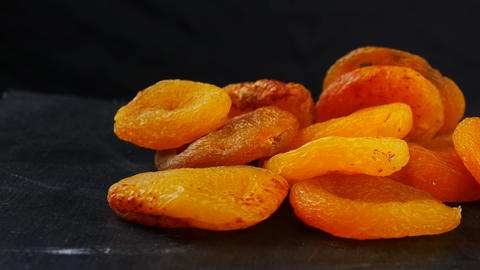 Naturally dried apricots on black background, Live Action