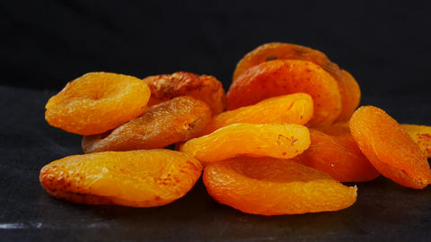 Naturally dried apricots on black background Footage