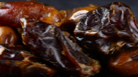 pitted dates on black background Live Action
