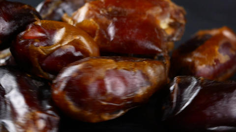 pitted dates on black background Stock Video Footage