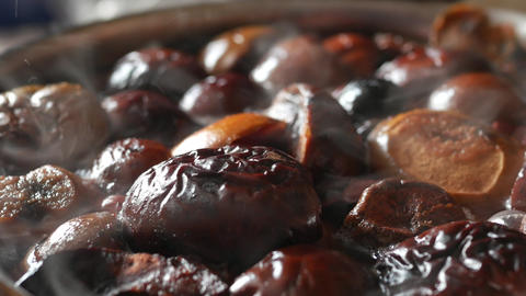 Plums and apples being turned into syrup with a vanilla pod. stewed fruit - Footage