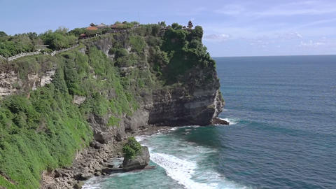 Temple on a Rock above the Ocean Shore Image