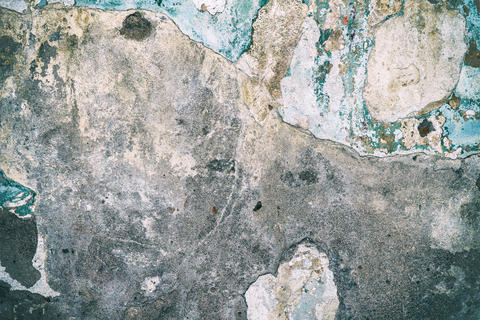 Cement wall with old paint Photo