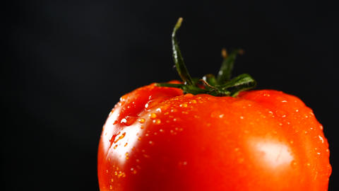 organic red tomato on black background Footage
