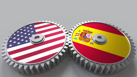 Flags of the USA and Spain on meshing gears. International cooperation Footage