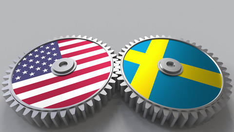 Flags of the USA and Sweden on meshing gears. International cooperation Footage