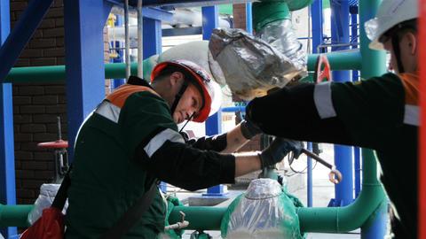 Skilled Workers Repairs Gas Metal Pipe with Tools Footage