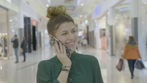 Portrait of a teenager girl laughing and nodding while talking on the phone in Footage