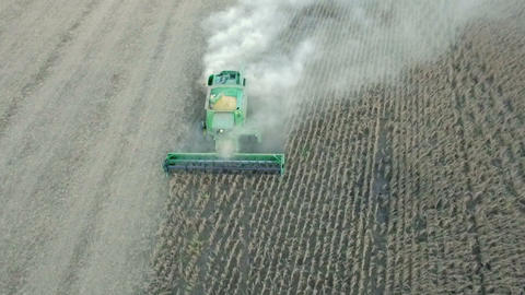 Aerial top view of harvester machine Live Action