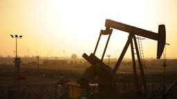 Oil Pump working at Sunset in Bahrain Footage