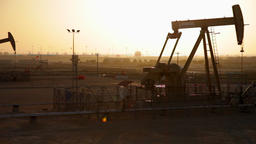 Oil Pumps working at Sunset in Bahrain Footage