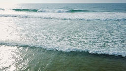 Aerial View Of Ocean Waves And Beautiful Beach in Slow Motion Footage