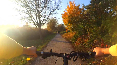 extreme girl rides a bicycle along the river bank Footage