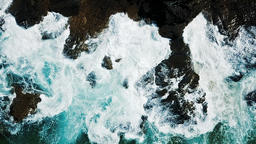 Aerial View Of Dramatic Ocean Waves Crushing On Rocks in Slow Motion Footage