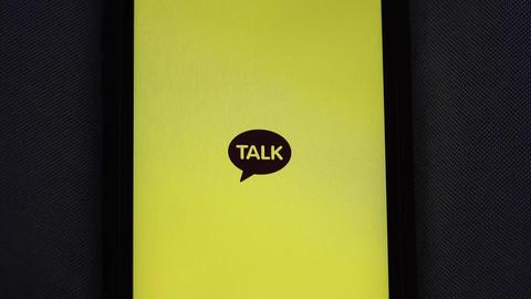 Message app KAKAO TALK logo on iphone screen ビデオ