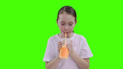 Nice girl drinking through a straw drink. Green screen Stock Video Footage