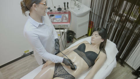 Millennial female getting body lipo contouring and cellulite removal on belly by Live Action