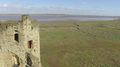 Close Flyby of Flint Castle Turret with View of Dee Estuary Live Action