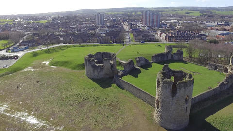 Flint Castle on a Bright Spring Day with Flint Town in the Background Live Action