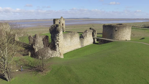 Flying Over Flint Castle with Flyby Close to Castle Turret Live Action