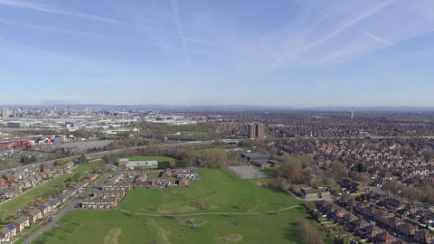 Rise and Descent Over Urban Park with Manchester in View to the Left Footage