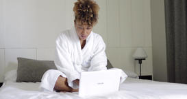 Charming woman on bed with laptop Footage