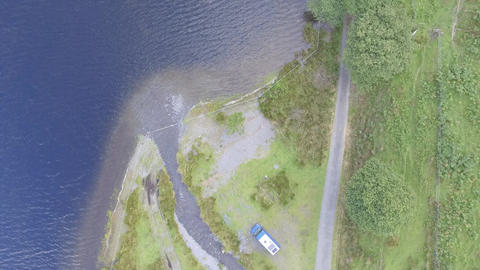 An Ascending Aerial Shot Over the Edge of Tal-y-Llyn Lake Footage
