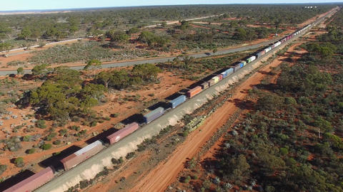 hfreigt train travels through the Australian savannah (aerial view) Footage