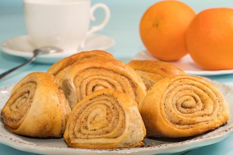 Buns with cinnamon on a plate. Fresh bakery Photo