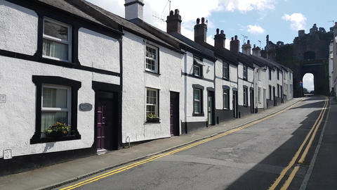 Conwy Town Row of Cottages and Town Castle Walls 2 Stock Video Footage
