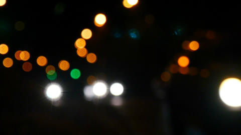 Cars in the defocus. Beautiful bokeh. Light and color spots Footage