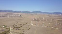 Aerial shot of windmills in desert Footage
