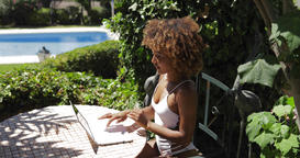 Charming model relaxing with laptop in poolside Footage
