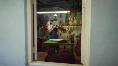 1 Man Lute Maker Artisan Opening Shop Fixing Guitar Footage