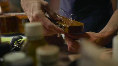 3 Man Lute Maker Artisan Changing String To Guitar Footage