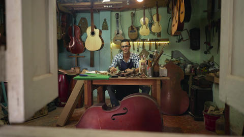 9 Portrait Young Man Lute Maker Smiling At Camera In Shop Footage