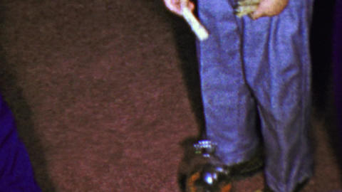 1963: Drop closepin bottle cheater puts hand too close in jeans Live Action
