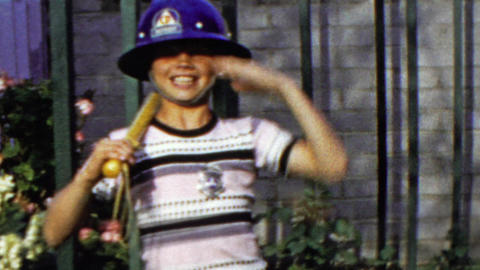 1964: Middle school aged salutes military march fireman hat costume Footage