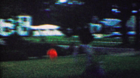 1963: Glowing ball catch game throw nighttime backyard last light Footage