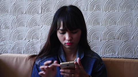 female sad expression using smartphone Footage