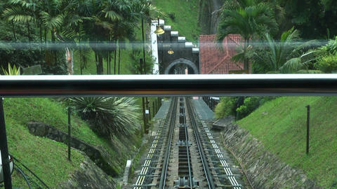 A tram railway on Penang Hill, Malaysia, People use Penang Hill Train track Live Action