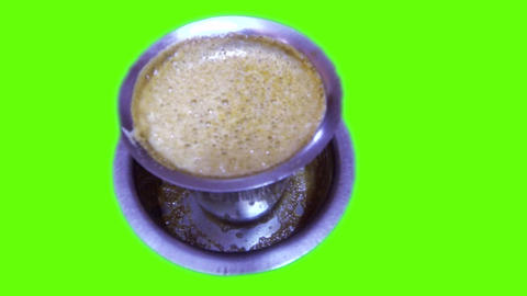 Hot filter coffee in a steel glass in green screen Live Action