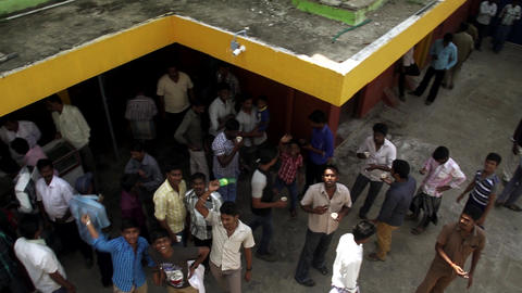 Top angle - People eat and relax in theater during intermission at India Live Action