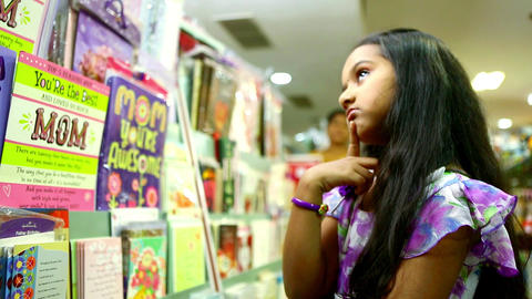 Girl thinking on shopping mall Live Action