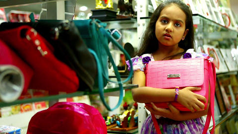 Little girl shopping bag on her hands Footage
