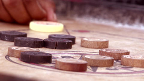 Indian man playing traditional Indian board game carom board Footage