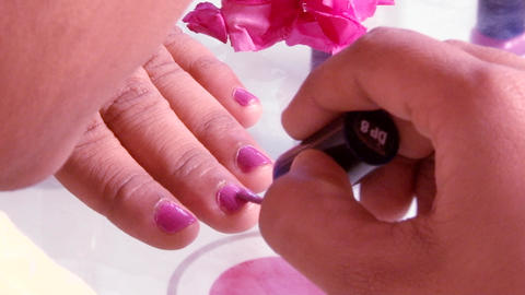 Closeup shot of a woman applying nail polish in hand Footage